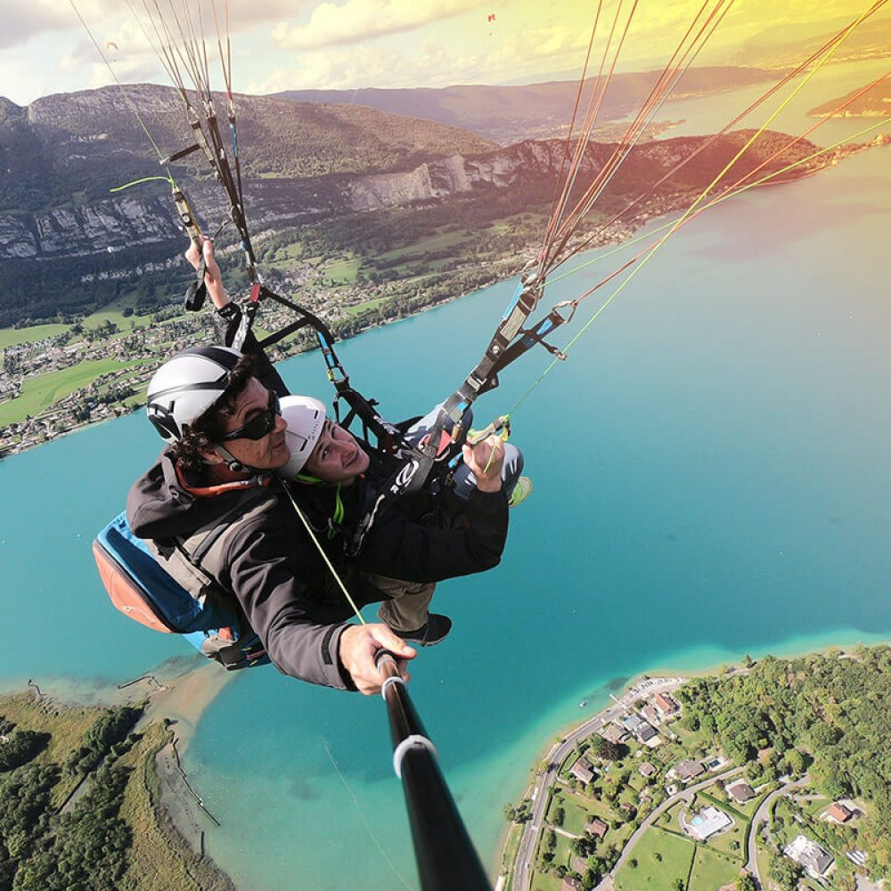 Paragliding flight over lake annecy